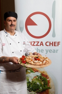 Tony Macera, from Hamilton, Glasgow with his Four Cheese, Parma Ham & Olive Pizza