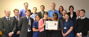 AAGBI President Dr William Harrop-Griffiths (Front Row: 3rd from left) presents the Pask Certificate of Honour to the doctors and nurses at Royal United Hospital Bath NHS Trust for their courage in saving patients from the ICU fire