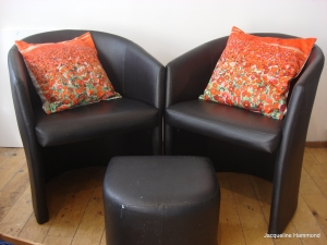 Poppy cushions on leather chairs