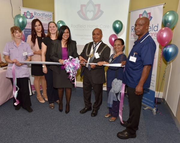Ribbon cutting ceremony with Kingston Mayor Thay Thayalan and Radfield Home Care Richmond, Kingston and Hounslow Owner and Director Shamsah Lalji