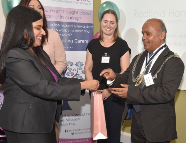 Radfield Home Care Branch Owner and Director Shamsah Lalji presents Mayor Thayalan with a small gift